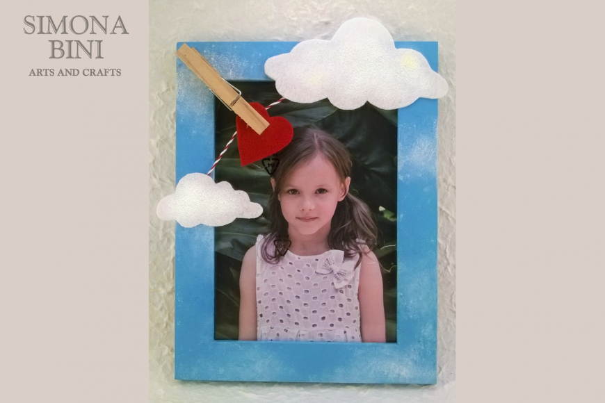 Cornice con le nuvole – Frame with clouds